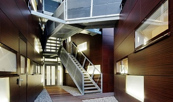 Each and every detail well thought out - staircase with access to the lift and to the individual apartments